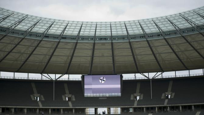 An animation of a soccer ball behind a goal line is displayed during a presentation of the Hawk-Eye goal-line technology which will be used for the first time in Germany during the German Cup final at the Olympic stadium in Berlin
