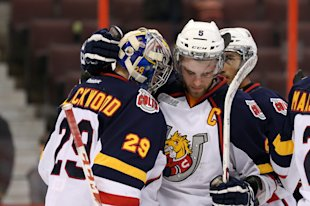 OTTAWA, ON - MARCH 13: Aaron Ekblad #5 congratulates teammate Mackenzie Blackwood #29 of the Barrie Colts following a win against the Ottawa 67's duri...