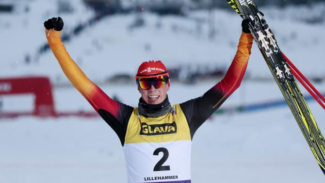 Eric Frenzel of Germany celebrates after winning the FIS World Cup Nordic Combined Cross Country in Lillehammer