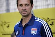 Lyon coach Remi Garde, pictured in July 2012, confirmed Wednesday that his club are in negotiations with Paris Saint-Germain that could lead to a swap deal involving Anthony Reveillere and Milan Bisevac
