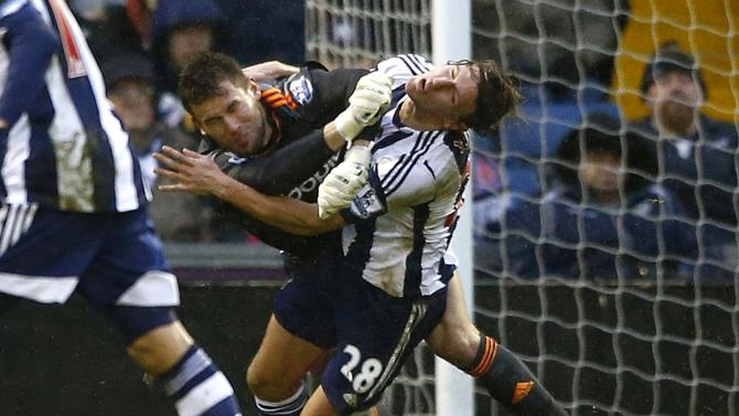 West Bromwich Albion goalkeeper Foster collides with team mate Jones during their English Premier League soccer match against Newcastle United in West Bromwich
