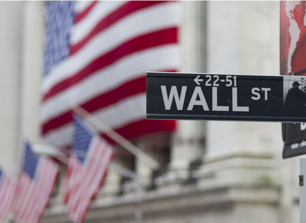 FILE - In this Aug. 8. 2011, file photo, a Wall Street sign hangs near the New York Stock Exchange. Stocks slipped in early trading Friday, May 22, 2015, as energy companies fell along with the price