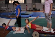 Young Chinese gymnasts are seen being trained in Hefei, east China's Anhui province, under the watchful eyes of coaches from the Anhui gymnastic team which has produced numerous world class gymnasts, including the current Chinese Olympic women's team member Deng Linlin
