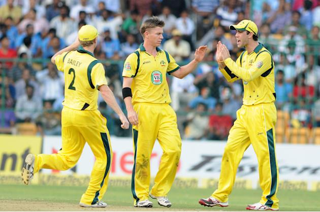 Australian players celebrate fall of a wicket during the 7th ODI between India and Australia played at Chinnaswamy Stadium in Bangalore on Nov.2, 2013. (Photo: IANS)