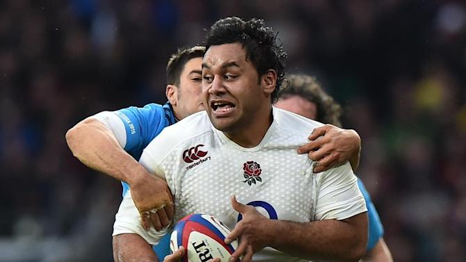 England's number 8 Billy Vunipola is tackled during the Six Nations international rugby union match against Italy at Twickenham Stadium on February 14, 2015