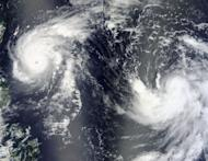 NASA image taken on August 21 shows Typhoon Tembin (L) and Typhoon Bolaven (R) in the Philippine Sea. One of the most powerful typhoons in decades hit Japan's Okinawa on Sunday, with meteorologists warning it could bring record rain and wind to the southern region and waves of up to 13 metres (43 feet)
