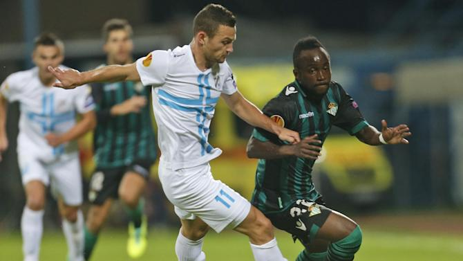 Betis' Cedric, right, is challenged by Rijeka's Ivan Tomecak during their group I Europa League first round second leg soccer match, at Kantrida stadium in Rijeka, Croatia, Thursday, Oct. 3, 2013