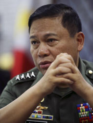 "Philippine Military Chief Emmanuel Bautista answers questions during an interview at Camp Aquinaldo military headquarters in suburban Quezon city, north of Manila, Philippines on Thursday, Feb. 20, 2014. Bautista says Beijing's territorial claims in the South China Sea are ""nonsense"" and vowed to defend fishermen if they face intimidation by Chinese naval forces in the waters. (AP Photo/Aaron Favila)"