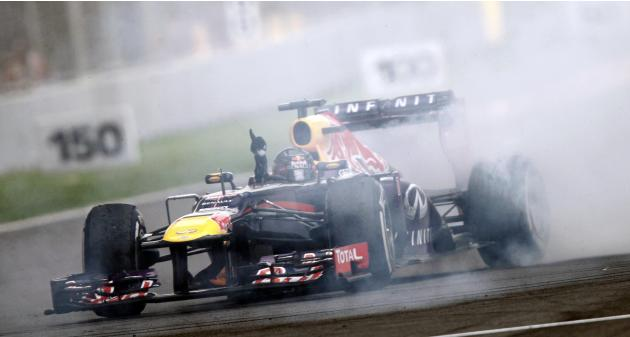 Red Bull Formula One driver Vettel does a burnout to celebrate winning the Indian F1 Grand Prix at the Buddh International Circuit in Greater Noida