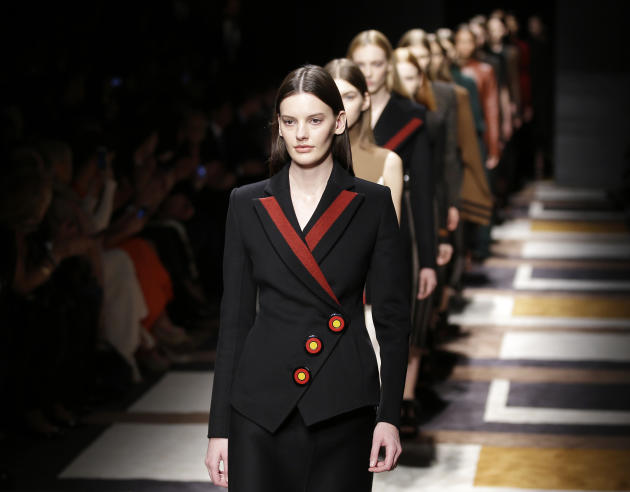 Models wear creations for Salvatore Ferragamo women's Fall-Winter 2015-2016 collection, part of the Milan Fashion Week, unveiled in Milan, Italy, Sunday, March 1, 2015. (AP Photo/Antonio Calanni)