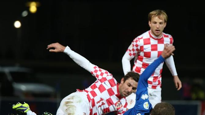 Iceland's Gylfi Thor Sigurdsson, no. 10, challenges Croatia's Dario Srna for the ball during their World Cup qualifying playoff first leg soccer match in Reykjavik, Iceland, Friday Nov. 15, 2013