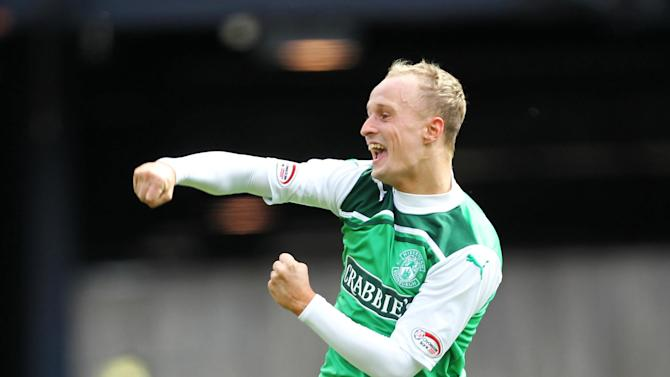 Leigh Griffiths struck a double to guide Hibs to victory