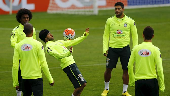 Brazil's player Alves controls a ball during a team training session in Santiago