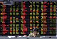 A Thai investor stands infront of an electronic shares price display at the stock exchange in Bangkok, 2009. Asian markets were generally higher, their third consecutive positive session, as traders looked for new stimulus measures from European and US central banks