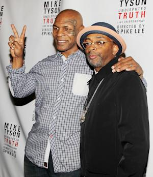 "This image released by Starpix shows, former boxer Mike Tyson, left, and Spike Lee pose backstage after the curtain call on the opening night of ""Mike Tyson: Undisputed Truth,"" Thursday, Aug. 2, 2012 at the Longacre Theatre in New York.  The one man show starring Tyson was directed by Spike Lee, and written by Tyson's wife Kiki. (AP Photo/Starpix, Amanda Schwab)"