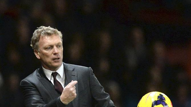 Manchester United manager Moyes throws the ball back onto the pitch during their English Premier League soccer match against Tottenham Hotspur in Manchester