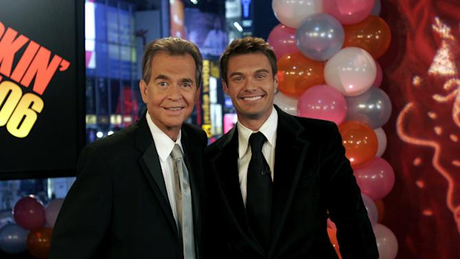 """FILE - This Jan. 1, 2006 file photo originally released by ABC shows Dick Clark, left, posing with Ryan Seacrest in New York.  Clark, the ever-youthful television host and tireless entrepreneur who helped bring rock `n' roll into the mainstream on """"American Bandstand,"""" and later produced and hosted a vast range of programming from game shows to the New Year's Eve countdown from Times Square, died of a heart attack on Wednesday, April 18, 2012. He was 82.  (AP Photo/ABC, file)"""