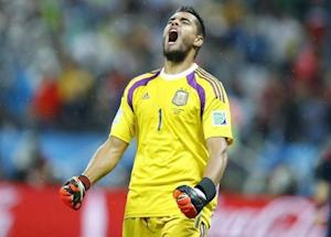 Argentina's goalkeeper Romero reacts after saving a goal attempt from Vlaar of the Netherlands during a penalty shoot-out during their 2014 World Cup semi-finals at the Corinthians arena in Sao Paulo