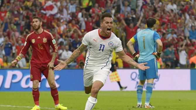 Chile's Eduardo Vargas celebrates after scoring the opening goal during the group B World Cup soccer match between Spain and Chile at the Maracana Stadium in Rio de Janeiro, Brazil, Wednesday, June 18, 2014