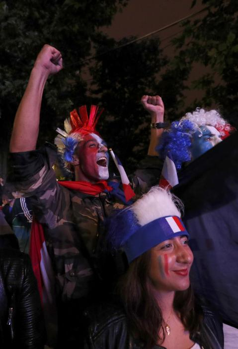 France fans react in the fan zone during a EURO 2016 quarter final soccer match