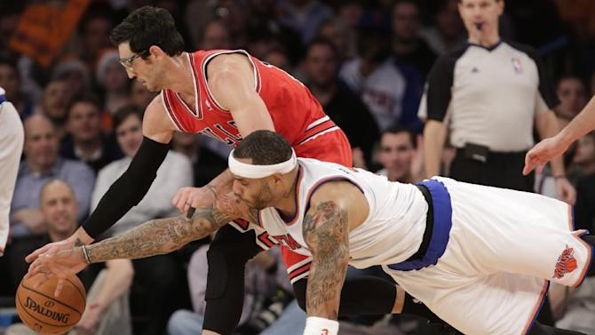 New York Knicks forward Kenyon Martin (3) dives for the ball as Chicago Bulls guard Kirk Hinrich (12) dribbles in the first half of their NBA basketball game at Madison Square Garden in New York, Wednesday, Dec. 11, 2013