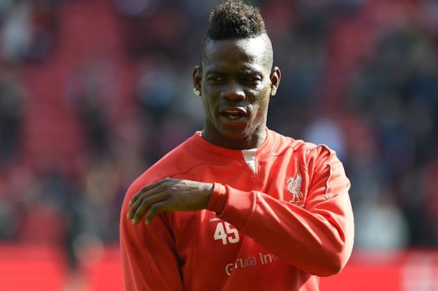 Liverpool's Italian striker Mario Balotelli warms up ahead of the English Premier League football match between Liverpool and Manchester United at Anfield in Liverpool, England on March 22, 2015