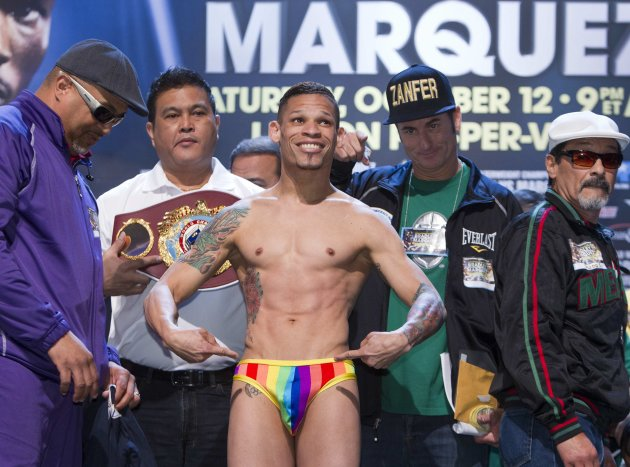 Featherweight boxer Orlando Cruz of Puerto Rico poses during an official weigh-in at the Wynn Las Vegas in Las Vegas, Nevada October 11, 2013. Cruz, boxing's first openly gay fighter, and Orlando Salido of Mexico will fight for a vacant WBO featherweight championship at the Thomas & Mack Center on October 12. REUTERS/Steve Marcus (UNITED STATES - Tags: SPORT BOXING TPX IMAGES OF THE DAY)