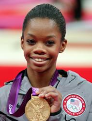 Gabrielle Douglas of the United States celebrates after winning the gold medal in the Gymnastics Women's Individual All-Around final at the London 2012 Olympic Games on August 2, 2012 -- Getty Images
