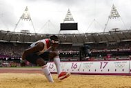Britain's Phillips Idowu fails an attempt as he competes in the men's triple jump qualifying rounds at the athletics event during the London 2012 Olympic Games. Chinese athletics icon Liu Xiang endured a dreadful repeat of his Beijing Olympics heartbreak as he suffered a suspected ruptured Achilles tendon