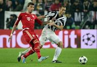 Juventus defender Giorgio Chiellini (R) and Bayern's Mario Mandzukic are pictured during their Champions League match on April 10, 2013. Mandzukic and Claudio Pizarro netted in the second half to give Bayern a 2-0 victory