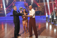 "In this image released by ABC-TV, war veteran and actor J.R. Martinez, right, and his partner Karina Smirnoff hold their award with host Tom Bergeron after they were crowned champions of the celebrity dance competition series, ""Dancing with the Stars,"" Tuesday, Nov. 22, 2011 in Los Angeles. (AP Photo/ABC-TV, Adam Taylor)"