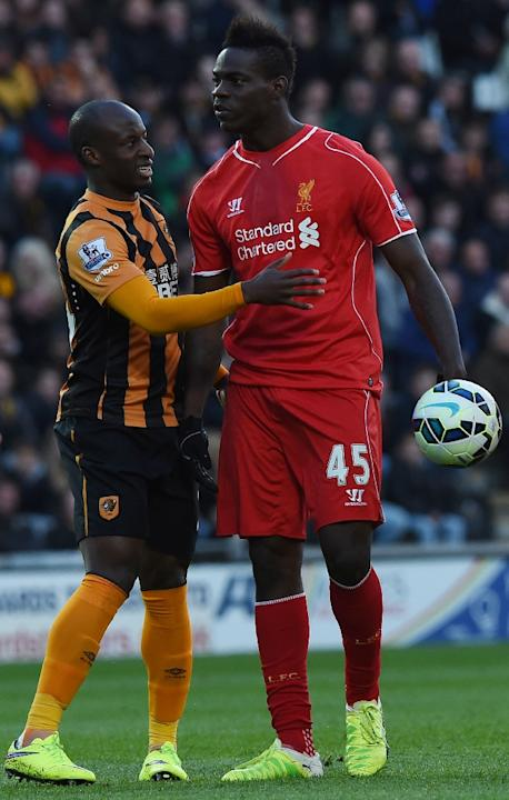 Mario Balotelli (right) with Hull City's Sone Aluko during a Premier League match between Liverpool and Hull at the KC Stadium in Hull on April 28, 2015