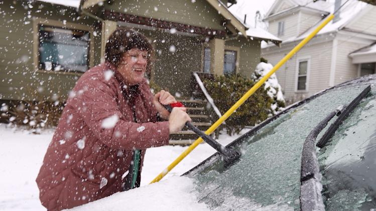 Melissa Moffitt, an on-call physician at Oregon Health & Science University, scrapes ice off her car in Southeast Portland so she can go to work on Sunday, Feb. 9, 2014. Randy L. Rasmussen/The Oregonian (AP Photo/The Oregonian, Randy Rasmussen) MAGS OUT; TV OUT; LOCAL TV OUT; LOCAL INTERNET OUT; THE MERCURY OUT; WILLAMETTE WEEK OUT; PAMPLIN MEDIA GROUP OUT MBI (REV-SHARE)