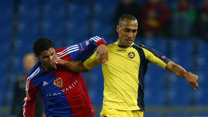 FC Basel's Elneny fights for the ball with Maccabi Tel Aviv's Radi during their Europa League second leg soccer match in St.Jakob-Park stadium in Basel