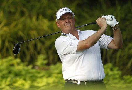 Montgomerie of Scotland tees off during the first round of the Barclays Singapore Open golf tournament in Sentosa