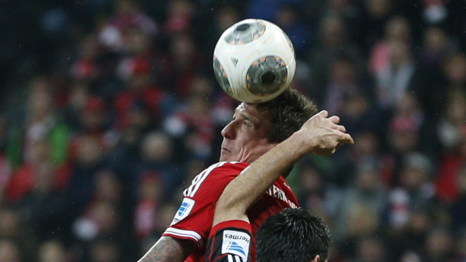 Bayern's Mario Mandzukic of Croatia, rear, and Leverkusen's Emir Spahic of Bosnia challenge for the ball during the German first division Bundesliga soccer match between FC Bayern Munich and Bayer 04 Leverkusen, in Munich, southern Germany, Saturday, March 15, 2014