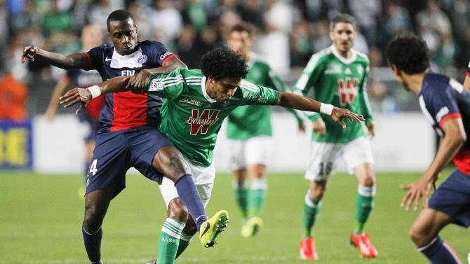 Matuidi of Paris St-Germain challenges Brandao of St Etienne during their French Ligue 1 soccer match at the Geoffroy Guichard stadium