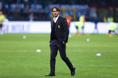 AC Milan's coach Filippo Inzaghi walks on the pitch before their Italian Serie A soccer match against Inter Milan at San Siro stadium in Milan