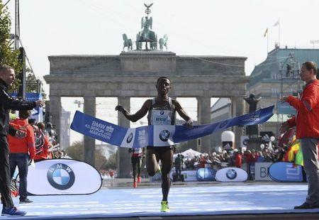Bekele of Ethiopia crosses the finish line to win the men's competition at the Berlin marathon in Berlin