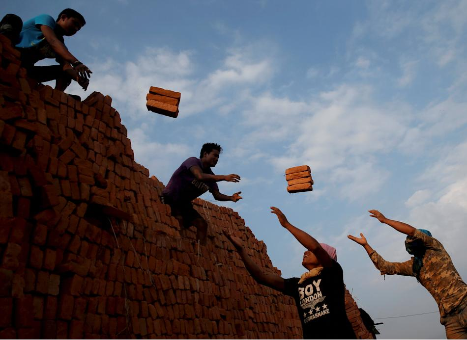 Men work at a brick factory in Bhaktapur