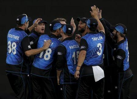New Zealand team mates celebrate after South Africa's Faf du Plessis was caught behind during their Cricket World Cup semi final match in Auckland