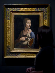 Francesca Sidhu looks at 'Cecilia Gallerani, The Lady with an Ermine' by Leonardo da Vinci, part of the ˜Leonardo da Vinci: Painter at the Court of Milan' exhibition shown at the National Portrait Gallery in London Monday, Nov. 7, 2011. (AP Photo/Jonathan Short)