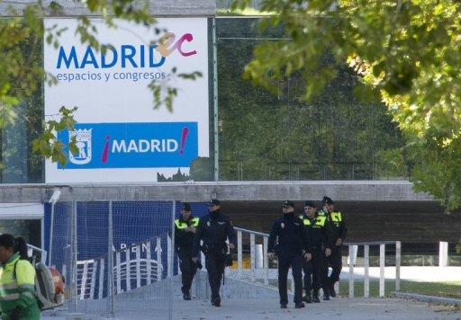 Spanish police officers walk near the entrance to the Madrid Arena stadium in Madrid on November 1, 2012. Madrid's deputy mayor resigned Wednesday over a deadly stampede at a Halloween rave party that killed five young women.