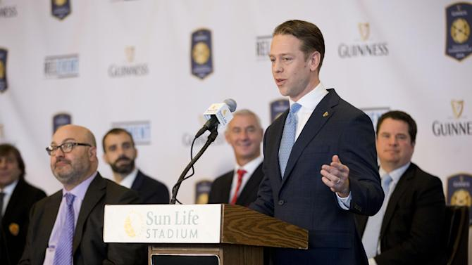 Jonathan Urch, senior brand manager for Guinness, speaks during the announcement of the lineup for the 2014 Guinness International Cup soccer tournament during a news conference at Sun Life Stadium in Miami Gardens, Fla. Eight teams will compete in the tournament in different cities in the U.S. from July 26 to Aug. 4, are Real Madrid CF, AC Milan, AS Roma, Inter Milan, Liverpool FC, Manchester City, Manchester United and Olympiacos