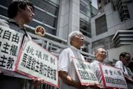 Chinese Cardinal of the Catholic Church and former bishop of Hong Kong, Joseph Zen Ze-kiun (C) takes part in a protest over religious freedom on mainland China, in Hong Kong. The demonstrators staged the protest following reports of the disappearance of a Chinese bishop and a priest amid a new row with the Vatican