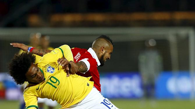 Willian of Brazil challenges Vidal of Chile during their 2018 World Cup qualifying soccer match in Santiago