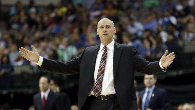 Dallas Mavericks head coach Rick Carlisle opens his arms while coaching from the sideline during the first half of an NBA preseason basketball game against the Orlando Magic in Dallas,  Monday, Oct. 14, 2013
