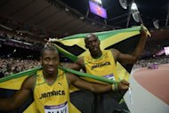 Jamaica's Usain Bolt (R) celebrate with Yohan Blake after winning the Olympics men's 100m final on August 5. Blake has long lurked in the shadows cast by teammates Bolt and Asafa Powell, but roared to prominence as the potential successor to Bolt after his performances at the trials