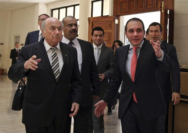 FILE - In this Monday, May 26, 2014.file photo Sepp Blatter, President of FIFA, left, is greeted by FIFA Vice President, Jordan's Prince Ali Bin al-Hussein, right, prior to their meeting on the first day of Blatter's regional tour to Jordan, the Palestinian territories and Israel, in Amman, Jordan. Ali Bin Al Hussein of Jordan will stand for election in a bid to oust Sepp Blatter as leader of football's scandal-hit world governing body. (AP Photo/Mohammad Hannon, File)