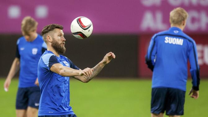 Finland's national soccer team player Maenpaa plays with a ball during a training in Bucharest